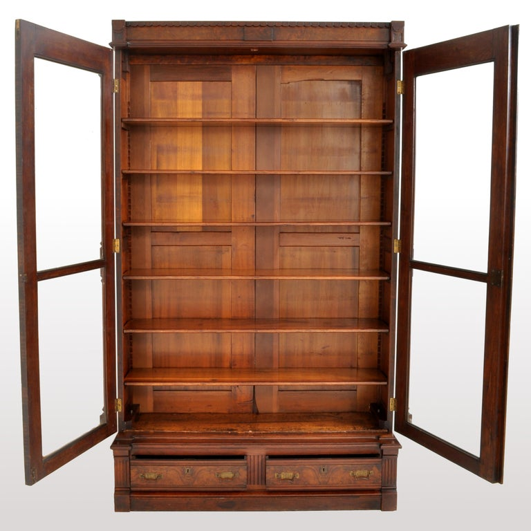 Antique American Renaissance Revival Eastlake Carved Walnut Tall Bookcase, 1875 For Sale 2