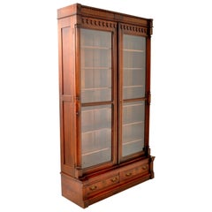 Antique American Renaissance Revival Eastlake Carved Walnut Tall Bookcase, 1875