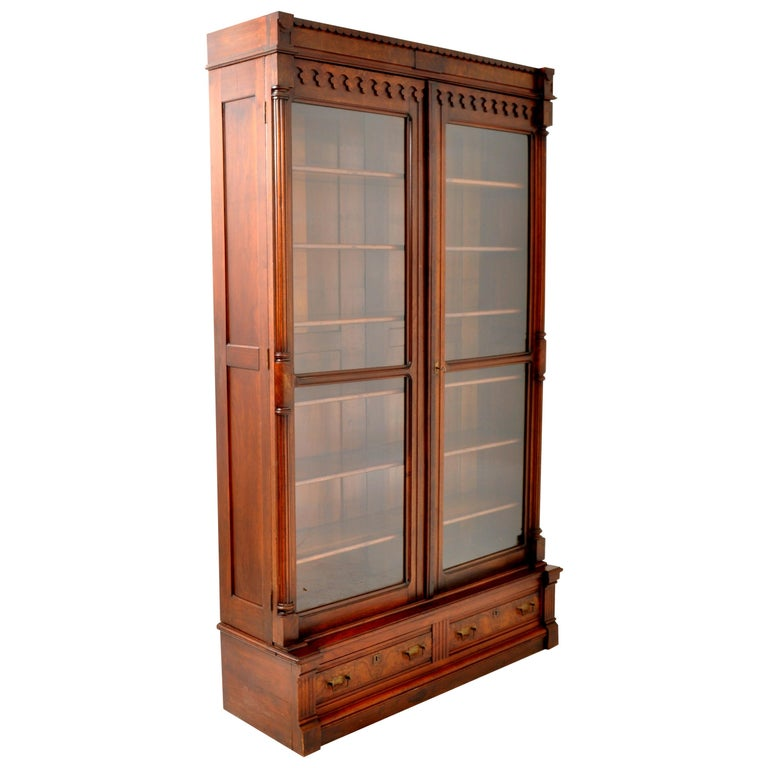 Antique American Renaissance Revival Eastlake Carved Walnut Tall Bookcase, 1875 For Sale