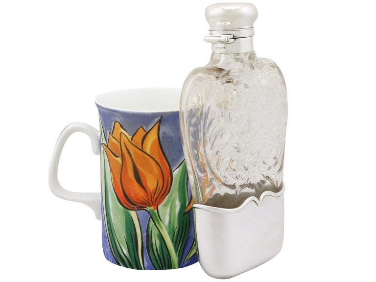 An exceptional, fine and impressive antique American blown glass and sterling silver mounted hip flask by Gorham Manufacturing Company; an addition to our silver mounted glass collection  This exceptional American antique glass and silver hip