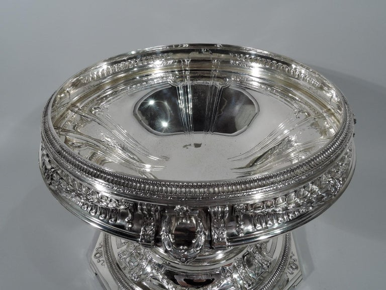 Adams style sterling silver centrepiece bowl on plateau. Made by Black, Starr & Frost in New York, circa 1890. Bowl: Curved and steeply tapering with turned-down rim and domed foot. Plateau: Octagonal and domed on corner bracket supports.