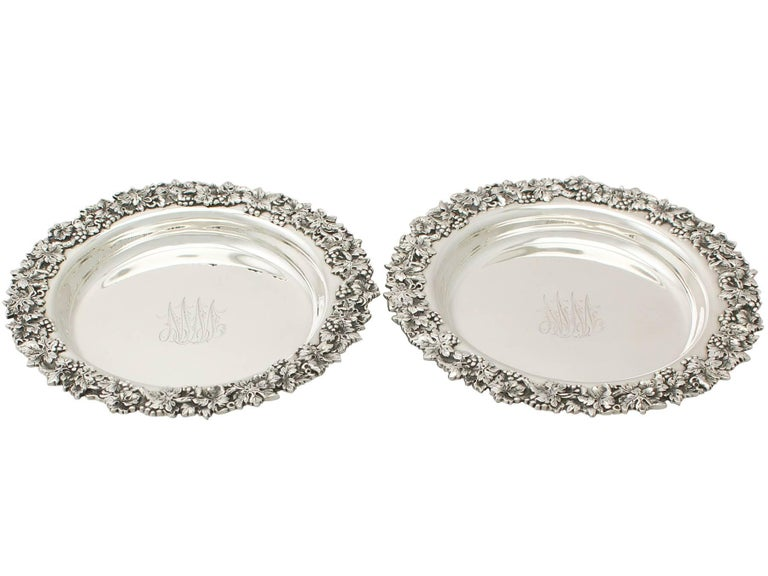 An exceptional, fine and impressive pair of antique American sterling silver coasters; an addition to our range of wine and drink related silverware.  These exceptional antique sterling silver wine coasters have a circular rounded form.  The