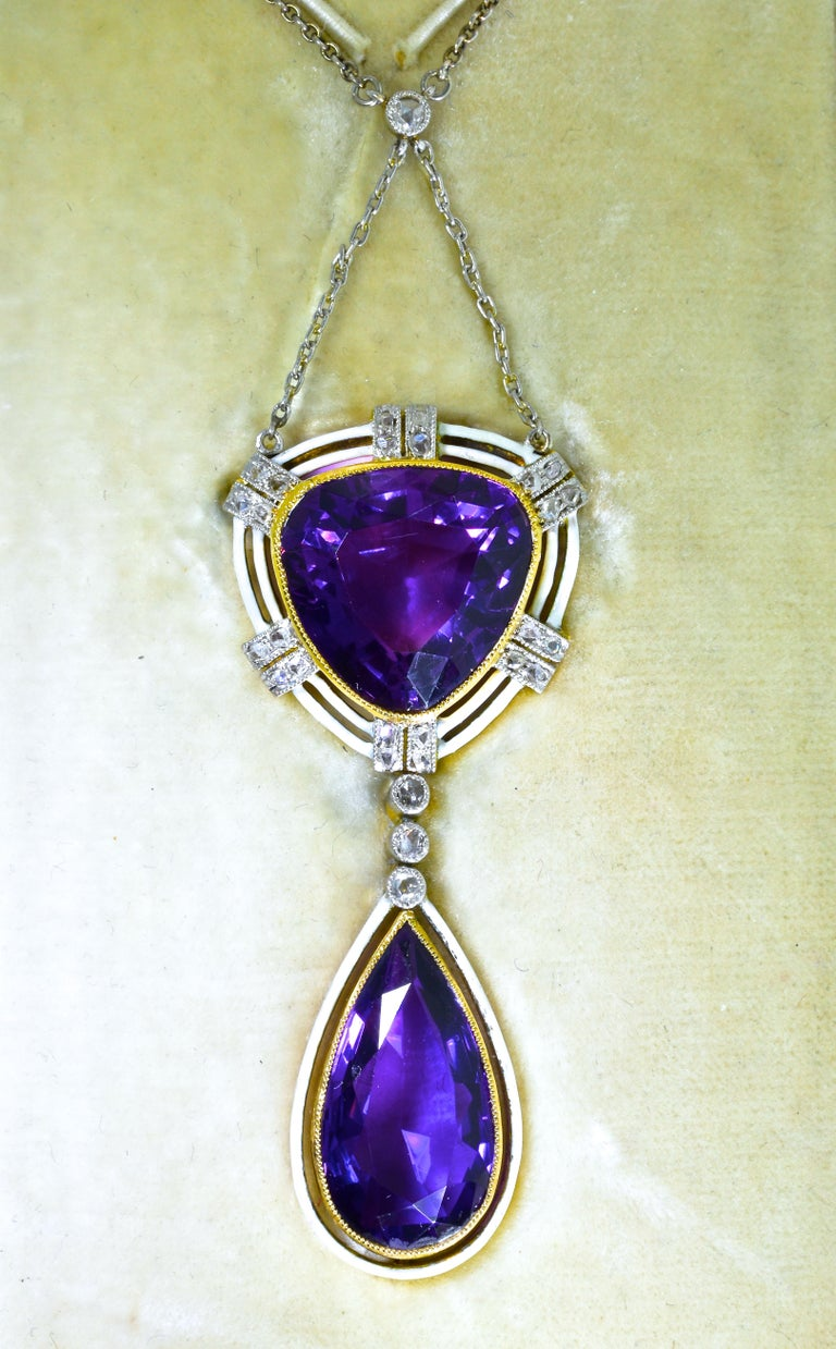 Antique Belle Epoque 18K gold, white enamel and very fine deep natural amethyst pendant suspended from a platinum chain.  The pendant  is 2 inches long and the chain can be worn either at a long 20 inches or use the shortener and wear it at 16.5