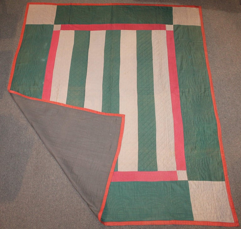 Antique Amish Bars quilt from Lancaster County, Pennsylvania. This quilt is from the 1930s wool and cotton sateen. The condition is very good with minor spots in area to be expected.
