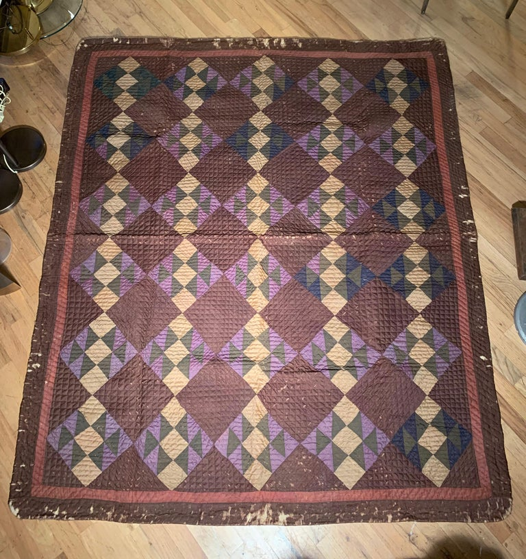 Beautiful old quilt attributed to the Amish. Very nice design and color pallet. We believe this to be early 20th century.