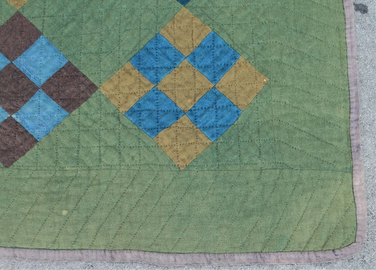 This Lancaster County, Pennsylvania all wool Amish nine patch quilt has minor wear in areas but not a big distraction. The colors are so amazing and rich. The quilt is a large generous size.