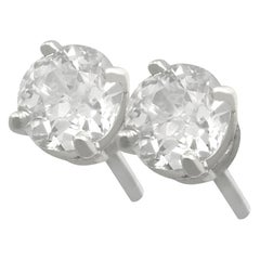 Antique and Contemporary 1.28 Carat Diamond and Platinum Stud Earrings