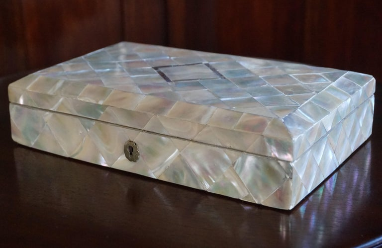 The largest mid-19th century mother of pearl box we ever saw.  This wonderful antique jewelry box is the largest of its kind that we ever had the pleasure of offering and it is inlaid with a diamond shape motif of abalone shell. This extremely