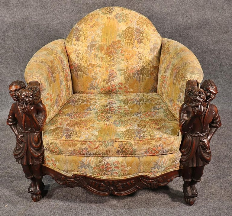 This is an exceptional antique Andrea Brustolon style figural carved walnut club chair with tapestry upholstery.