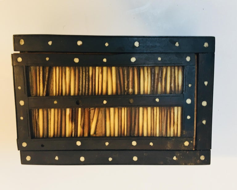 Antique Anglo-Indian quill box handcrafted in ebony and decorated with porcupine quills and bone dots.  Made in Ceylon which was the colonial name for Sri Lanka.
