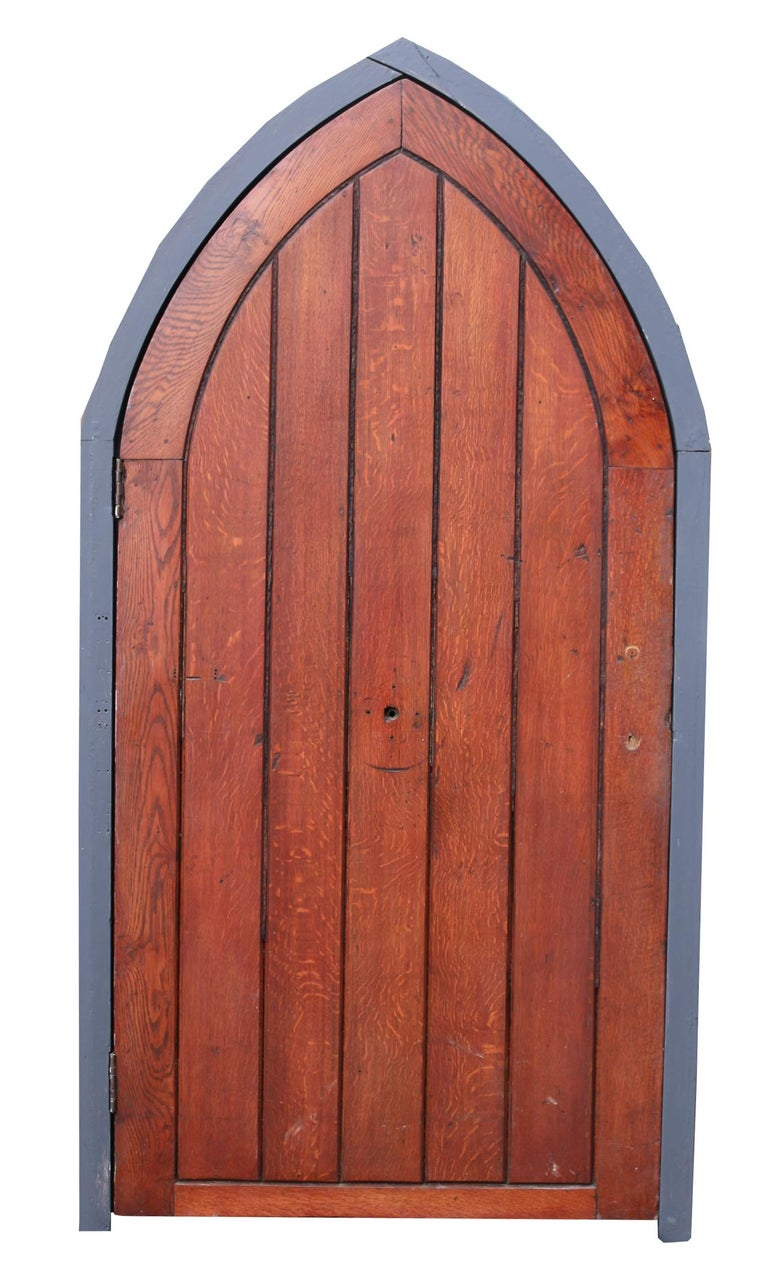 About  An antique arched oak door with a painted pine door frame.  Condition report  In good condition for its age and use, the frame has been painted in grey paint. There are some old marks left from previous hardware. The frame is in two