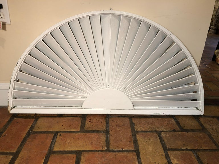 Antique architectural demilune sunburst window fragment. Half mooned fan like shape. Painted white on one side and weathered green paint on the other side. Two pieces have been antique architectural window fragment laced. Can be repainted any color.