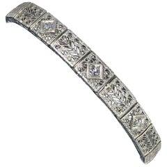 Antique Art Deco 14 Karat White Gold Diamond Three-Stone Filigree Bracelet