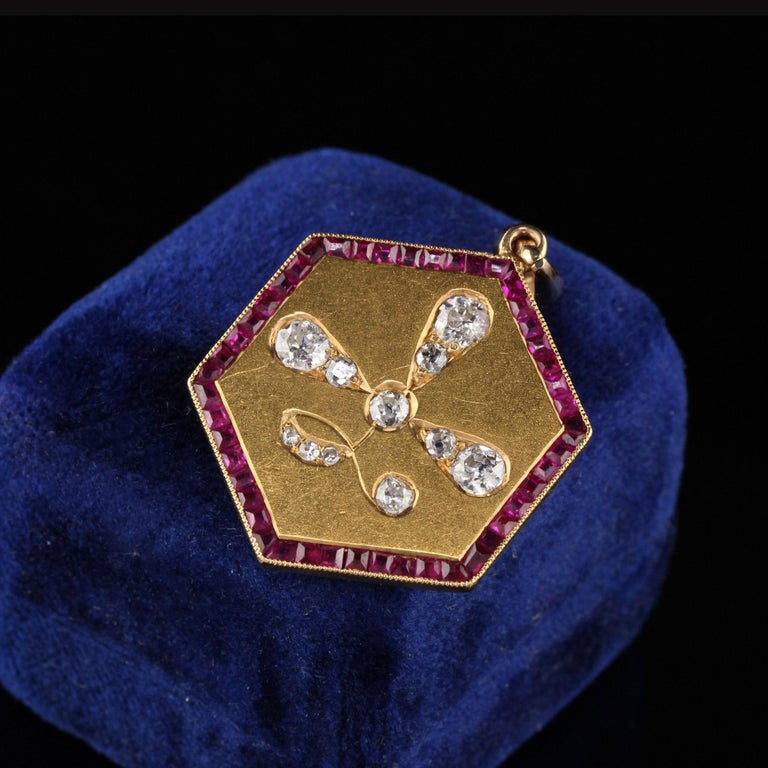 Beautiful antique pendant with rubies and old cut diamonds.   Item #N0035  Metal: 14K Yellow Gold  Weight: 10 Grams  Total Diamond Weight: Approximately 1.00 cts  Diamond Color: H  Diamond Clarity: VS2  Measurements: 40.7 mm x 2.05 mm