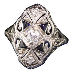 Antique Art Deco 18 Karat White Gold Diamond and Sapphire Shield Ring