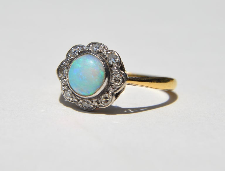 Round Cut Antique Art Deco .84 Carat Opal Diamond Halo 18 Karat Gold Engagement Ring For Sale