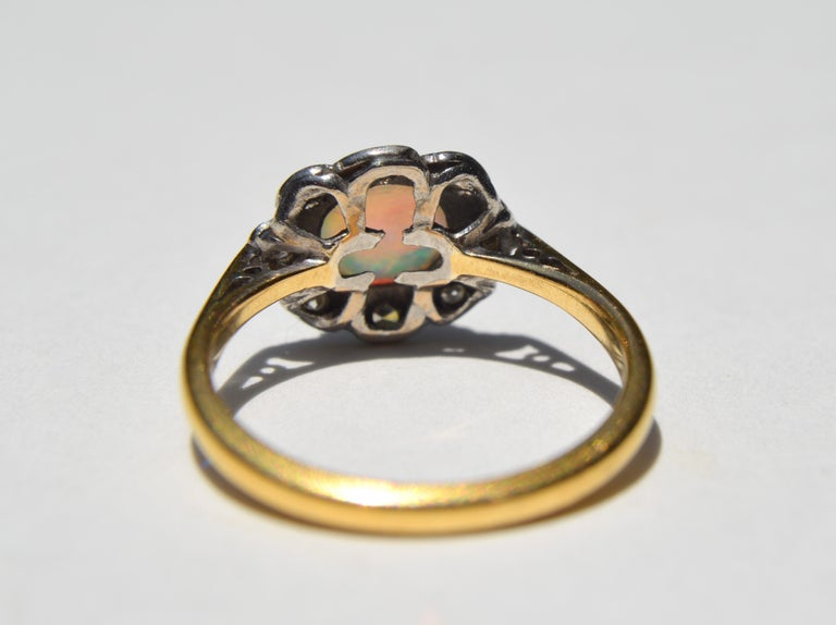 Antique Art Deco .84 Carat Opal Diamond Halo 18 Karat Gold Engagement Ring In Good Condition For Sale In Claremont, CA