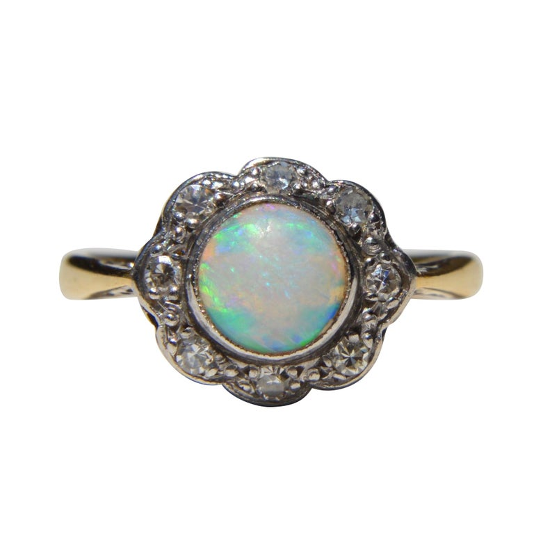 Antique Art Deco .84 Carat Opal Diamond Halo 18 Karat Gold Engagement Ring For Sale