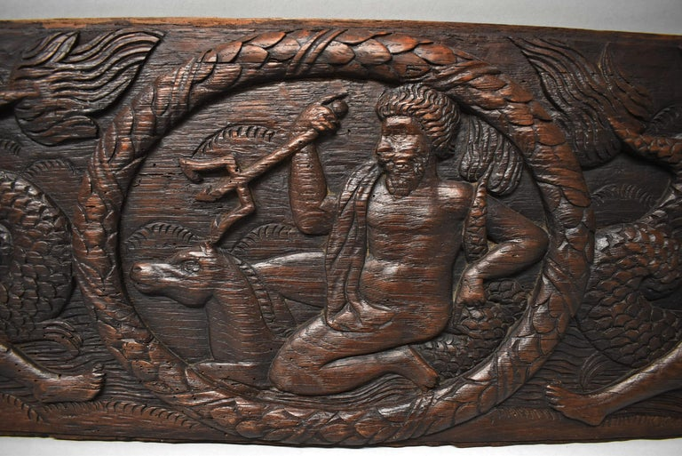Antique Art Deco carved oak panel of Neptune and sea serpent. Measures: 34.5