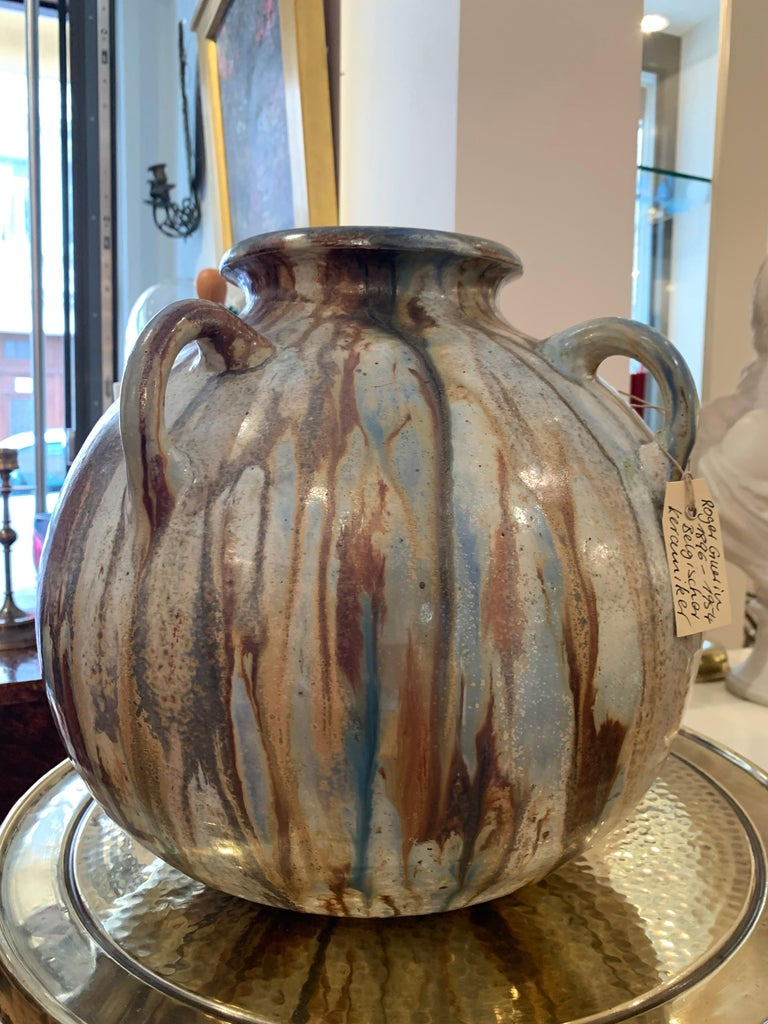 This substantial piece of studio pottery is by Belgian ceramicist Roger Guerin (1886 -1954) and fully signed Guerin on the base.