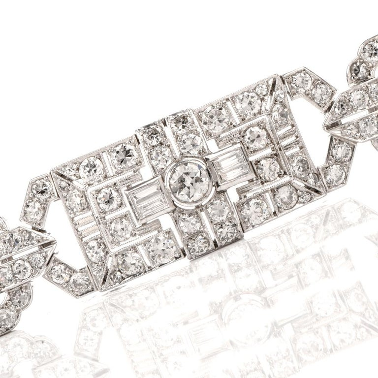 """This exquisite diamond bracelet is expertly crafted in solid platinum, weighing 44.3 grams and measuring 6 3/4"""" around the wrist x 15mm wide. Displaying of a stunning geometric open-work Art Deco pattern studded in an array of diamonds. Composed of"""