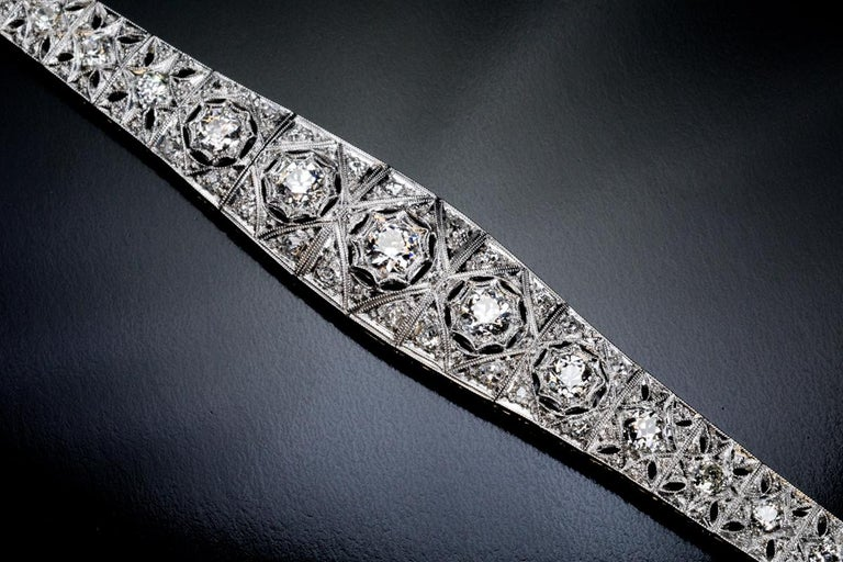 Early Art Deco, c. 1910s This very well made star motif platinum openwork bracelet is embellished with bright white old European and old mine cut diamonds (G-H color, SI1-SI2 clarity). Estimated total diamond weight is 3.70 carats. Length – 179 mm