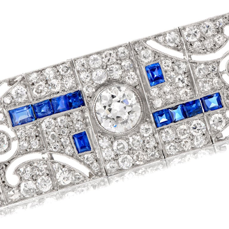 antique 1920's  Art Deco and abstract define the patterns running throughout  this beautiful antique bracelet.  Round European cut  diamonds and rose cut Sapphire adorn in repeating designs.  5 larger diamonds weigh appx. 2.75 carats.  Total