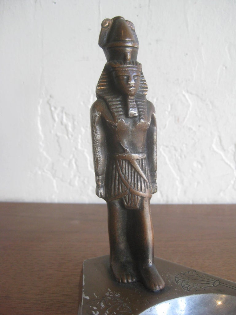Great Art Deco Egyptian Revival Pharaoh figural statue ashtray dating from the 1930s. Made from cast aluminum and has wonderful details. Still has most of the original brown cold paint on the surface. In very nice original condition with no cracks