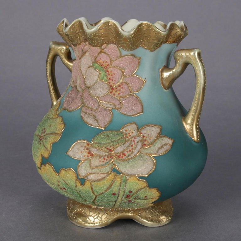 An antique Japanese Art Deco Nippon Coraline decorated vase features double handled bulbous form with ruffled rim and scroll form feet, all-over moriage decorated with flowers and heavy gilt banding, marked on base, circa 1920.