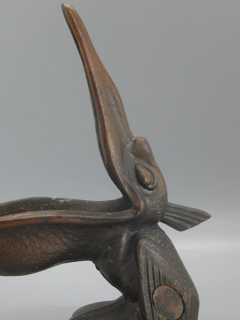 Beautiful antique Art Deco spelter metal with a bronze finish pelican bird figural cigar ashtray dating from the 1930s. The ashtray was a souvenir from Miami, Florida and is marked on the side. No maker marks but might be made by Jennings Bros. or
