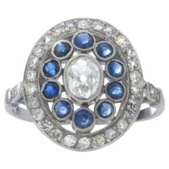 Antique Art Deco Period Platinum Ladies Ring with Diamonds and Blue Sapphires