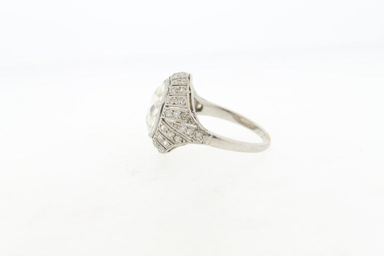 An early Art Deco platinum dome ring centering on an Old European cut diamond weighing approximately 4 carats. This ring was made around 1915. The diamond has a nice spread to it, looking like a larger diamond. It measures 10.1 mm in diameter and