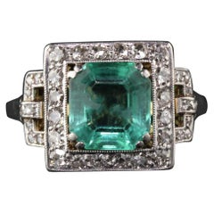 Antique Art Deco Platinum and 18 Karat Gold Diamond and Emerald Cocktail Ring