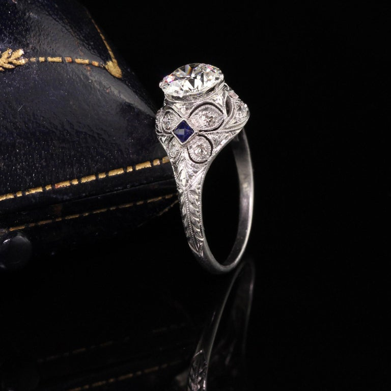 Gorgeous Antique Art Deco Platinum and Diamond Engagement Ring. This gorgeous engagement ring has a 1.03 ct center diamond that has butterfly designs on each side of the ring. It is a beautiful and pristine example of the art deco era.  Item