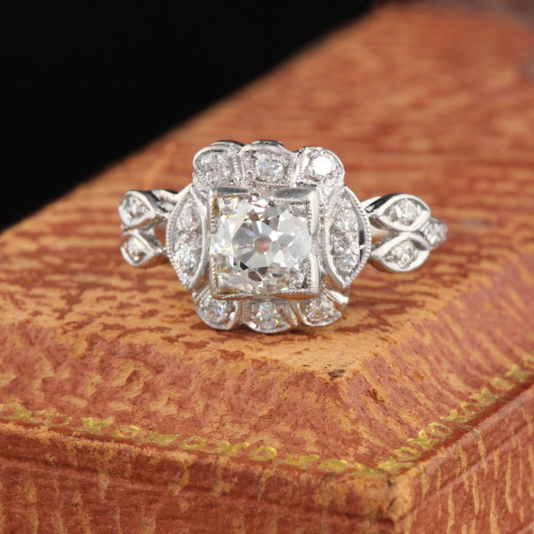Beautiful Art Deco engagement ring with a 1.11 ct GIA certified Old Mine Brilliant Cut center diamond and a floral design.   Item #R0021  Metal: Platinum  Weight: 4.1 Grams  Total Diamond Weight: Approximately 1.30 ctw  Center Diamond Weight: GIA