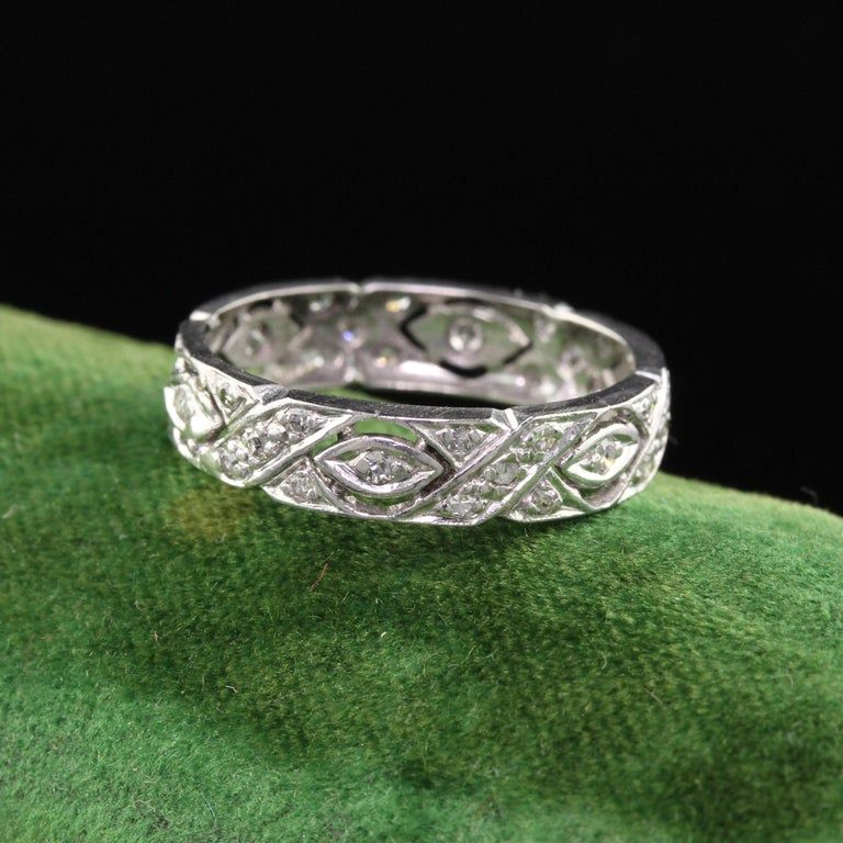 This is a gorgeous Art Deco Platinum Diamond Filigree Wedding Band. It is beautifully hand made and looks amazing on the finger. The design features alternating 'X' and marquise shapes.  #R0171  Metal: Platinum  Weight: 2.7 Grams  Total Diamond
