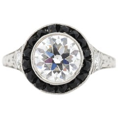 Antique Art Deco Platinum Diamond Onyx Halo Ring