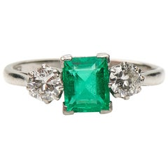 Antique, Art Deco, Platinum, Emerald and Diamond Three-Stone Engagement Ring