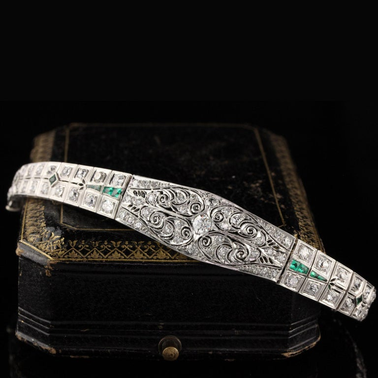 Stunning antique platinum bracelet with old european cut diamonds and emeralds.   Item #B0024  Metal: Platinum  Weight: 29.3 Grams  Total Diamond Weight: Approximately 5.50 cts  Diamond Color: H  Diamond Clarity: VS2 - SI1  Measurements: 7 in x 5.5