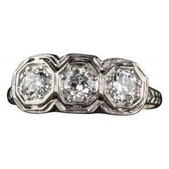 Antique Art Deco Platinum Old European Cut Three-Stone Ring