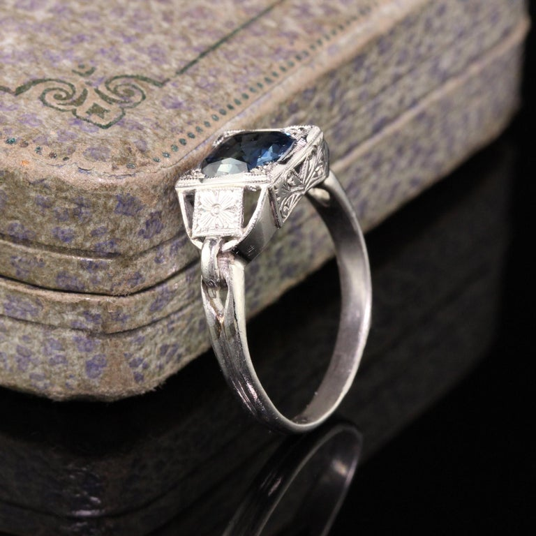 Magnificent Antique Art Deco Platinum Sapphire Engagement Ring. The sapphire is 1.99 ct in an intricate engraved art deco mounting. Truly gorgeous!  #R0598  Metal: Platinum  Weight: 5 Grams  Sapphire: Approximately 1.99 ct cushion  Ring Size: 7 3/4