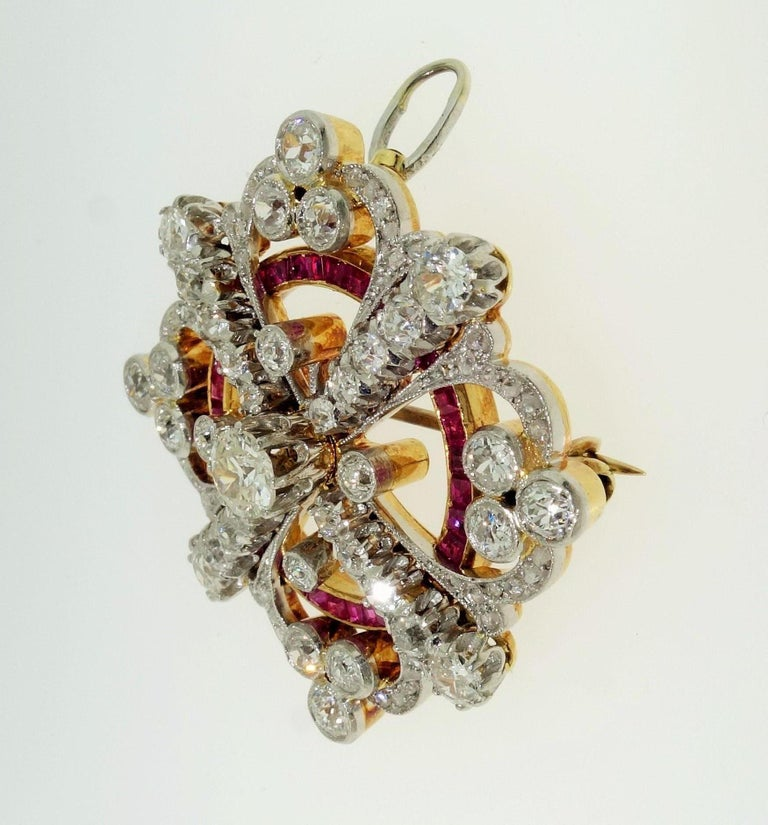Stylish and finely detailed Art Deco Natural Ruby and Diamond Brooch Pin Pendant; set with Rubies and Diamonds in Hand crafted Platinum and 18 Karat Gold mounting; Total diamond weight is approx. 2.00 carats; F/G color and VS clarity. The rubies