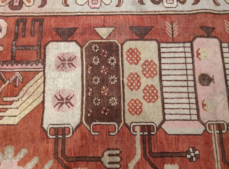 Woven during the Art Deco period, rugs of this type were commissioned by the nobility and the high ranking officers inhabiting the Tarim Basin in eastern Turkestan, which is the heartland of the oasis of Khotan, Yarkand and Kashgar. The rugs of