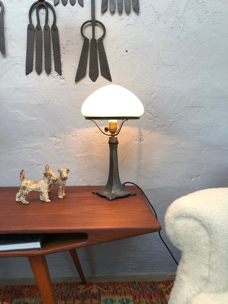 Danish Antique Art Deco Table Lamp in Cast Alloy with an Opaline Blown Glass Shade For Sale
