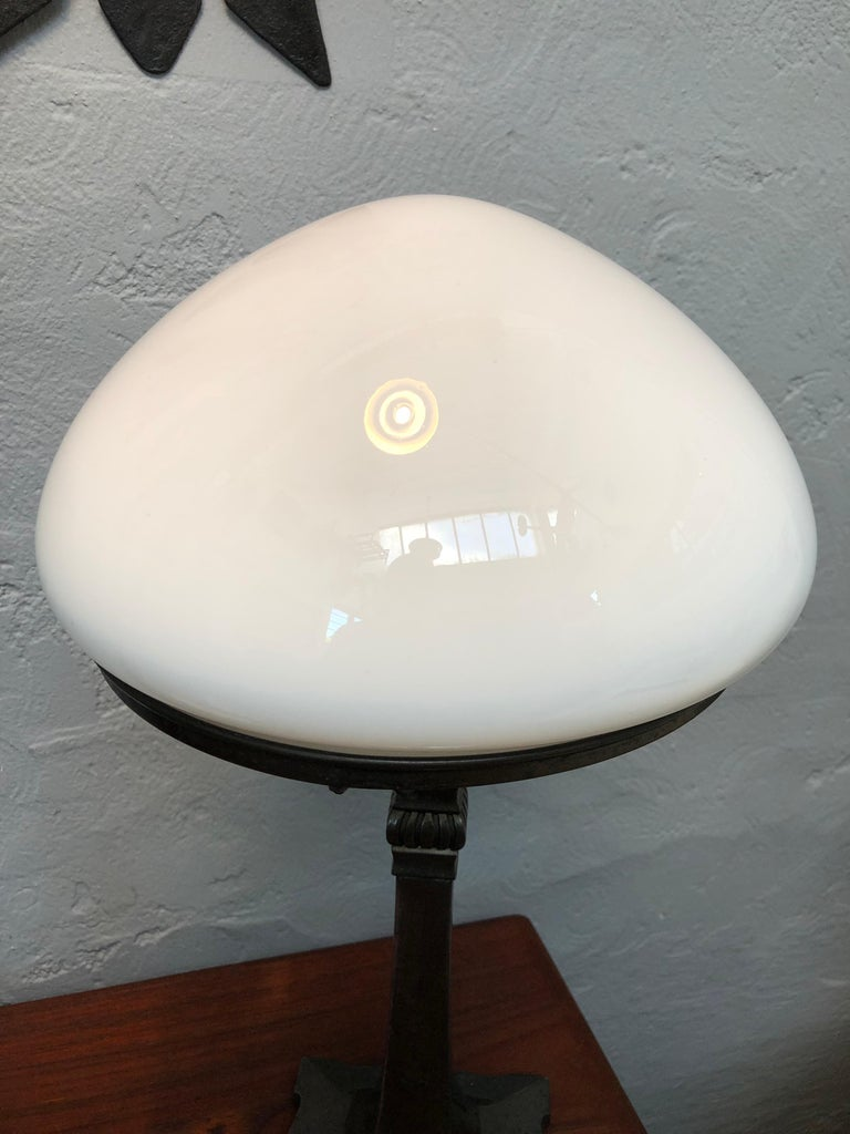 Metal Antique Art Deco Table Lamp in Cast Alloy with an Opaline Blown Glass Shade For Sale