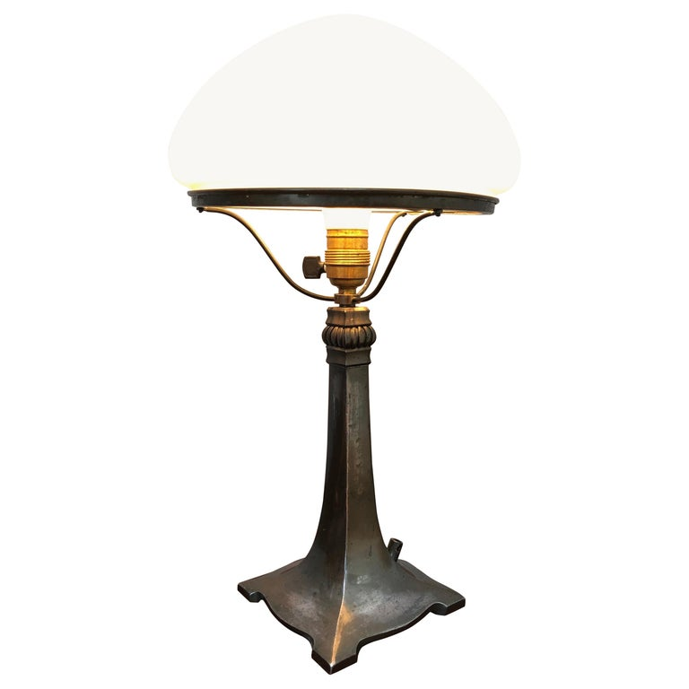 Antique Art Deco Table Lamp in Cast Alloy with an Opaline Blown Glass Shade For Sale