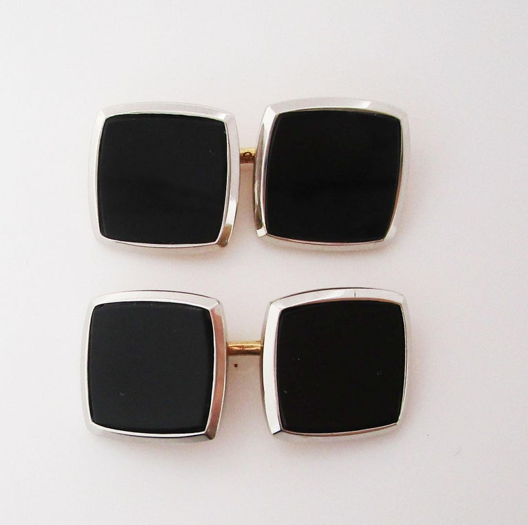 This elegant pair of cufflinks is original Art Deco links from 1920 in two colors of 14k gold with black onyx centers. The backs of the links are warm 14k yellow gold, while the frames of the panels are bright 14k white gold. The center of the