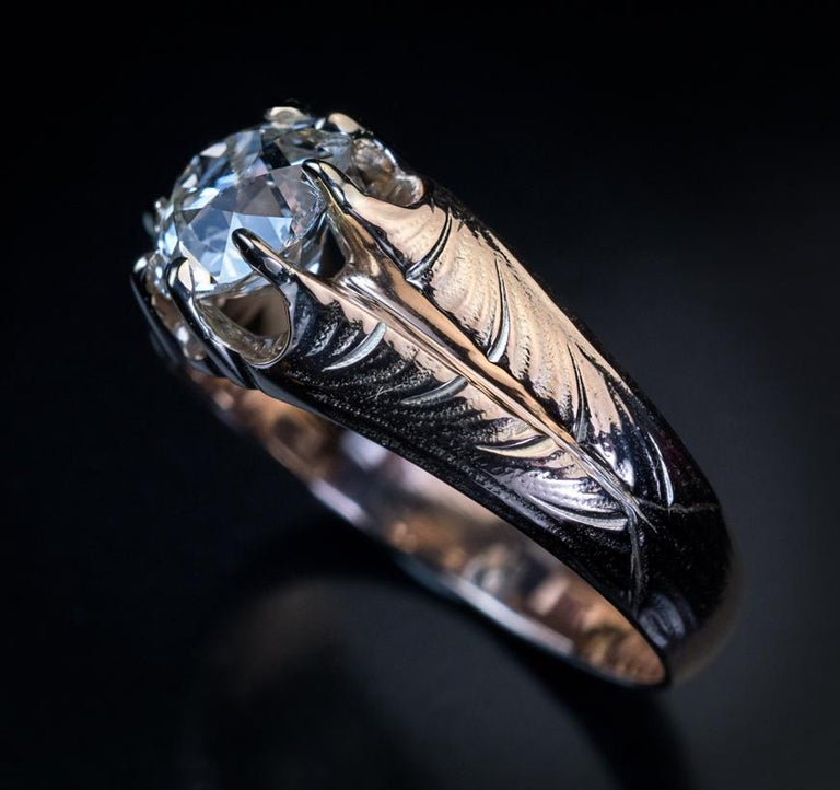This Art Nouveau era antique Russian unisex 14K gold ring was made in Odessa between 1908 and 1907.  The ring features a sparkling 1.70 ct old cushion cut diamond (K color, VS2 clarity) flanked by Art Nouveau leaf designs.  The diamond measures 7.61