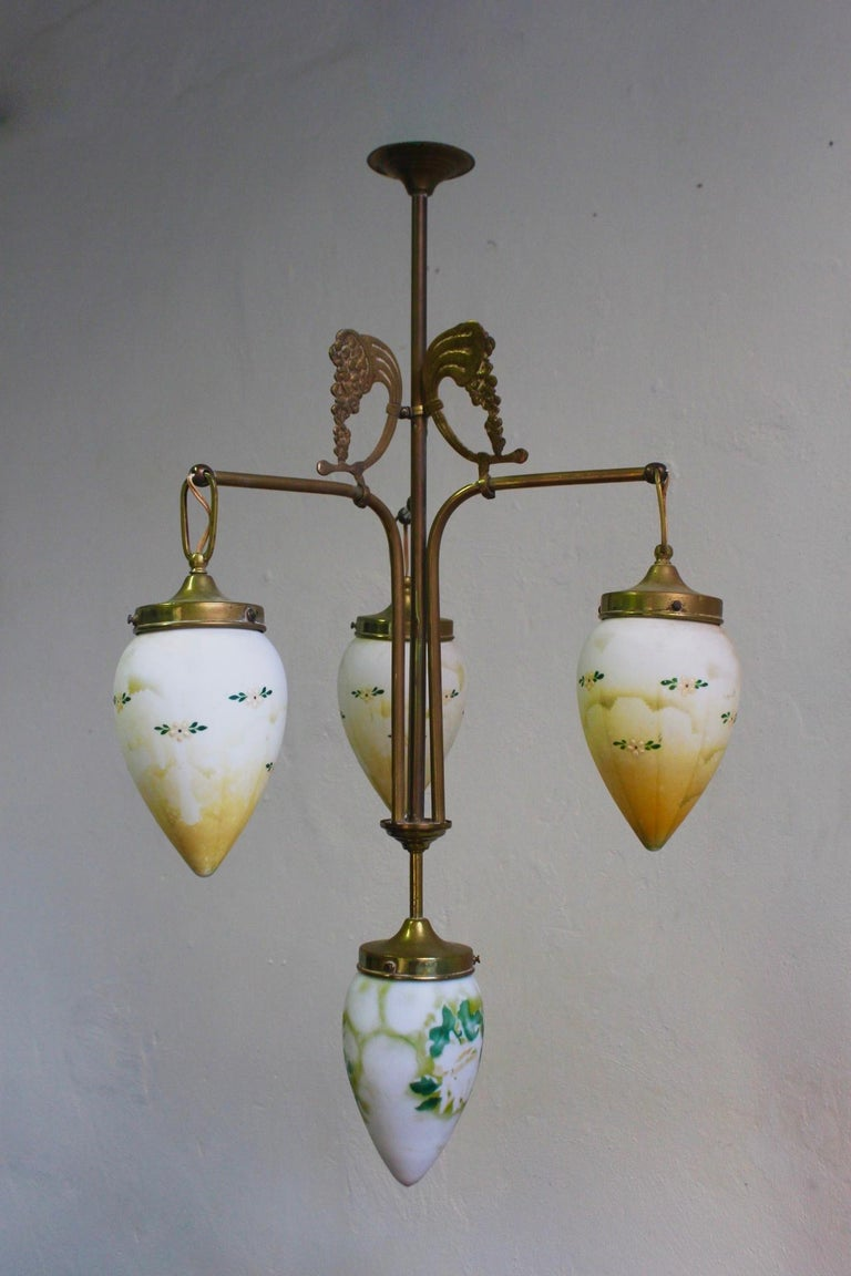 Unique antique Art Nouveau brass chandelier with hand painted milk glass shades, Spain, late 19th century.