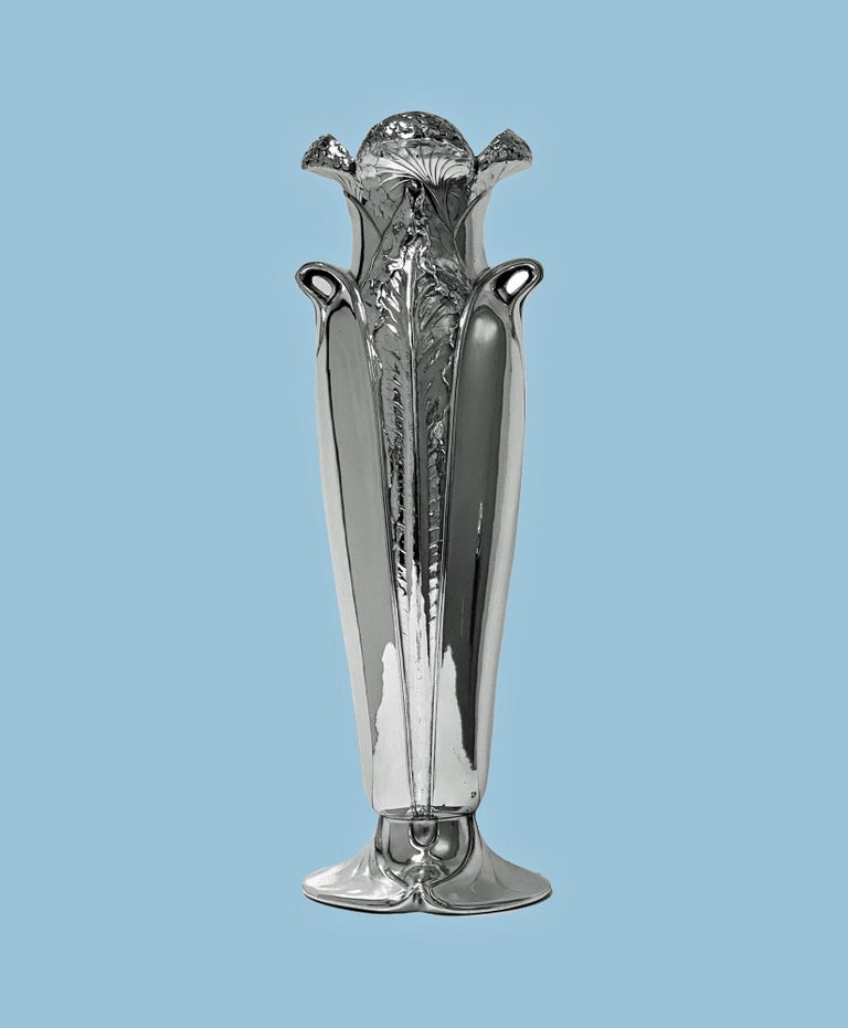 Antique Art Nouveau Christofle silver plate vase, France C.1900. The vase on oval swirl base rising to tapered bulbous form, elaborately decorated with raised tendril foliage design, the handles conforming, the top of open bud petal design. Overall